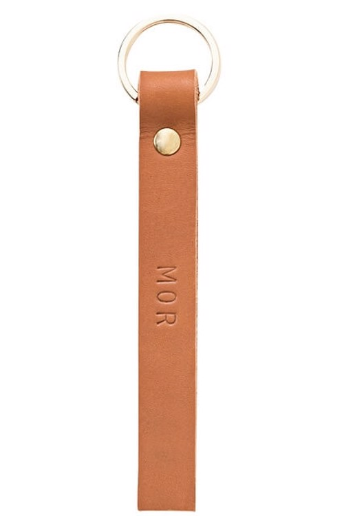 Key ring <br /> Cognac dyed leather, brass details and nature print