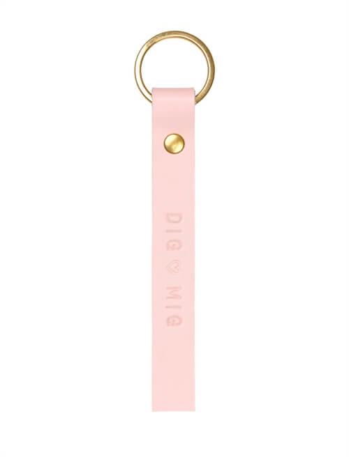 Key ring <br /> Rose dyed leather, brass details and gold print