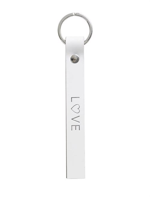 Key ring <br /> White dyed leather, silver details and silver print